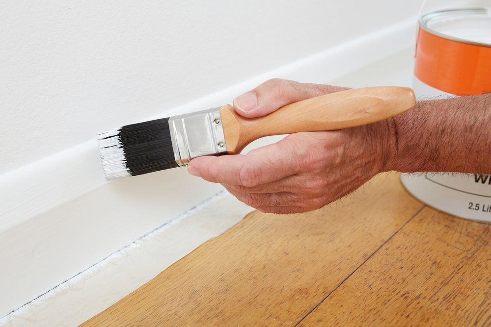 man glossing skirting board - handman hunter