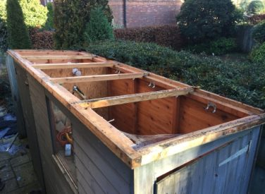 Re-Roofing-a-garden-shed-during-image-1